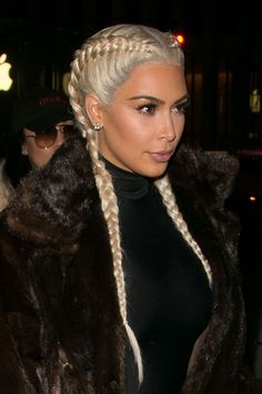 Since going platinum in 2015, Kim has given us a few did-she-or-didn't-she hair-color moments. But forget about the color for a minute and take note of the pigtail braids — they're the latest page in the family's ever-evolving beauty book. (And one that's being passed on to the next generation as well.) #refinery29 http://www.refinery29.com/2016/04/109151/kim-kardashian-makeup#slide-26