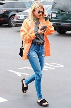 f312aa55f3e Sofia Richie looks effortlessly cool in her Fenty x Puma furry slides with  an orange jacket and jeans