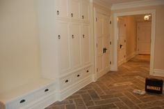 for the basement floors in slate herringbone pattern, and cabinets (to hide the washer/dryer)