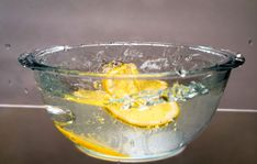 Lemon and Water in the Microwave Pour boiling water over lemons in a microwave-safe bowl, and cook in the microwave for five minutes. The steam will loosen any particles in the microwave so you can easily wipe it down; plus the lemons make it smell great.