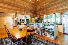 I like the way the lights unify the space, but the kitchen island's shelving divides it.