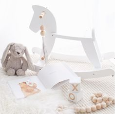 Whimsical whites featuring a Mocka white Wooden Rocking Horse styled by Oh.eight.oh.nine.