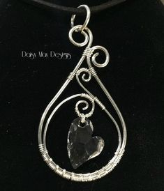 #301 - Swarovski Crystal asymmetrical heart pendant wire wrapped in solid sterling silver #wirejewelry