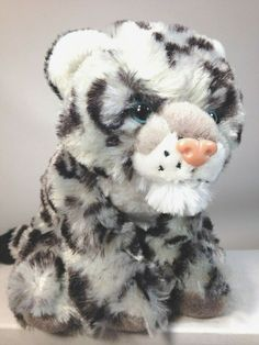"""Snow Leopards are commonly referred to as """"ghost cats"""" for a couple of reasons. One of them is because of their fur, as their white and grey colors blend into the snow and mountains where they reside. Leopard Cub, Snow Leopard, Baby Cubs, Disney Finding Dory, Stuffed Animal Cat, Ghost Cat, Pokemon Plush, Baby Chicks, Leopards"""