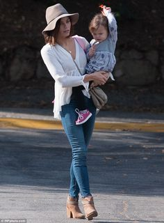 Simply stylish: Jenna, 34, teamed the slightly revealing top with a pair of blue skinny je...