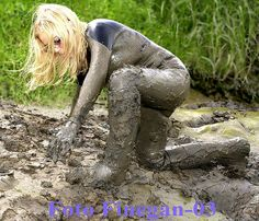 Muddy latex catsuit and waders