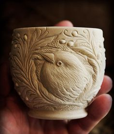 Artist Grace DePledge shares her process. Shown is a piece of porcelain greenware, with finished carving before firing in the kiln. See her portfolio at www.ArtsyShark.com