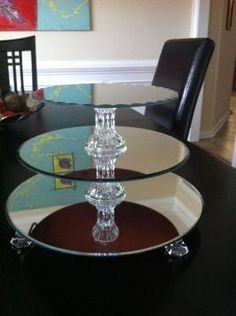 """DIY Cupcake stands made from mirrors and candle holders. Awesome!  My solution??  IKEA LOTS 11 3/4"""" mirror (4 pack for $6), Dollartree candle holder 5"""" square mirrors, glass taper candlestick holders for (2ct) spacers and clear square Luster Gems for the feet from Dollartree (all $1 each). Hold together with Loctite glass super glue ($3). Total cost for two stands: $14! by Rebeccalennox"""