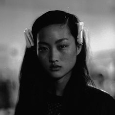 Her eyes are full of sadness that her mouth never got the chance to say. jing wen @ trussardi