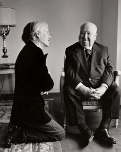 Warhol openly proclaimed that he was nervous upon meeting the legendary director, and posed with Hitchcock by kneeling at his feet.