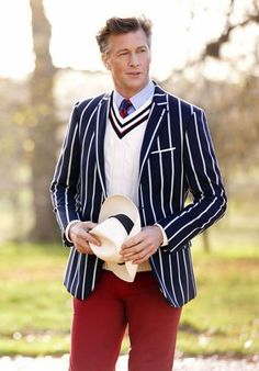 Shop this look on Lookastic:  https://lookastic.com/men/looks/blazer-v-neck-sweater-dress-shirt-chinos-hat-tie/12894  — Light Blue Dress Shirt  — Red and Navy Vertical Striped Tie  — White V-neck Sweater  — Navy and White Vertical Striped Blazer  — Beige Wool Hat  — Red Chinos