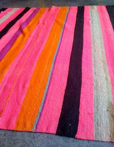 Bolivian rug in pink, orange, black, purple, taupe and turquoise. Whoa. #rug #color