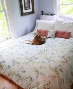DIY Duvet Cover with Two Flat Sheets. The sheets used for this tutorial aren't really my style but I love the idea.
