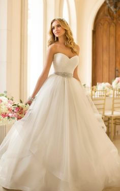 For the bride looking to add a little drama to her big day, this modern princess Tulle wedding dress ballgown from the Stella York collection features a number of sweet details, starting with its sweetheart neckline and ruched back.