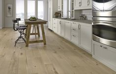 "Lancaster Oak has a rustic look with a light beige color and oak grain. This features an ultra wide, 7"" plank and has an antiqued feel - perfect for your home makeover!"