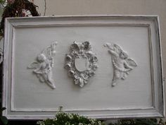 http://www.etsy.com/listing/84428376/chippy-white-antique-frame-with-vintage