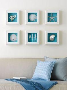 shells, white shadow box frames,brilliant blue background = beach inspired wall art by Prachi S