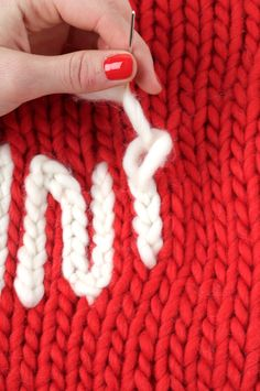 how to make a chain stitch to embroider words on knitted or crochet items