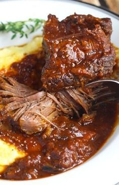 Beef Short Ribs cooked slowly in Red Wine until falling off the bone - Served with a Creamy Polenta. Low carb minus the polenta add cauliflower mash. Braised Short Ribs, Braised Beef, Beef Dishes, Food Dishes, Food Food, Veggie Food, Rib Recipes, Cooking Recipes, Polenta Recipes
