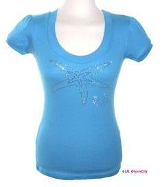 *Preissenkung von 49,00€ auf 40,00€.*  Sommerliches aqua- farbenes Shirt mit großem glitzernden Motiv mit farbigen Swarovski-Elements. Ideal für ...
