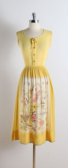 ➳ vintage 1950s dress * yellow semi sheer cotton * beautiful floral skirt print * button front * metal side zipper * by Laiglon condition | excellent fits like xs/s length 45 bodice 16 bust 36-38 waist 26 some clothes may be clipped on dress form to show best fit for appropriate size. ➳ shop http://www.etsy.com/shop/millstreetvintage?ref=si_shop ➳ shop policies http://www.etsy.com/shop/millstreetvintage/policy twitter | MillStVintage facebook | millstreetvintage instagram | millstreet...