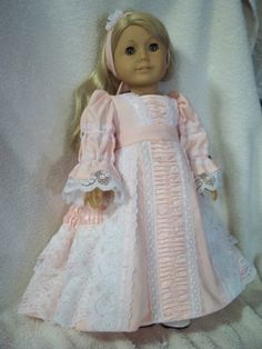This outfit is made by me to fit 18 American girl dolls and other similar sized dolls. The dress is made from a pretty pink cotton fabric . the