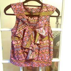 Sleeveless ruffle print blouse Fun, flirty print blouse, sleeveless, v-neck, Ruffles from sleeve to bottom of shirt. Worn once. Audrey Tops Blouses