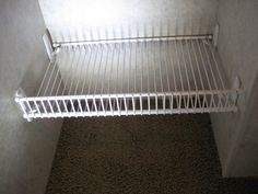 9 Inch Profile Wire Shelving and 3M Command Strip Hooks   I think this would be great for shoe shelf in an apartment.