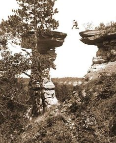 1886: Leaping the chasm at Stand Rock. Ashley Bennett, son of photographer H.H. Bennett, jumping to Stand Rock, caught in midair by the instantaneous shutter.