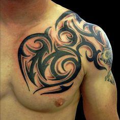 Tribal tattoo on shoulder man