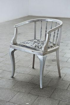 """Chair from the 30's. Woodwork covered with decorative acrylic paint in shades of silver and then made to look vintage. The upholstery is made from fabric of linen and cotton, covered with a painting. The author of the art work is well-known musician and composer - Czeslaw Mozil who by words: """"Millionaire from Ząbkowska street  is a bullshit! Rebel blue"""" expressed his emotion"""