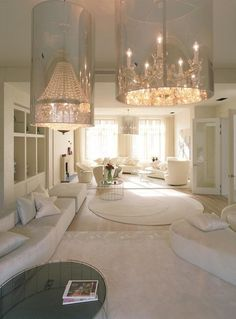 Clear cylindrical shades over chandeliers for an updated look. ZsaZsa Bellagio: The Glamorous Life. The Only Kind For Me.