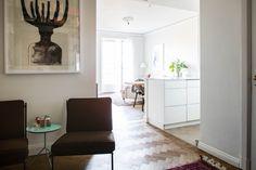 Scandi hallway decoration with dark brown chairs