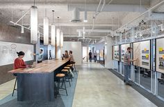 Uber. Collaboration space. Pin up space. Touchdown bar. Standing height meeting space