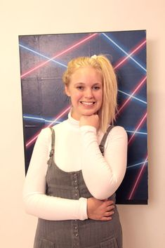Awkward School Photo Costume. She's wearing the background like a backpack. My school photos were before the option of nifty Laser Backgrounds which apparently peaked around '98. Great idea!