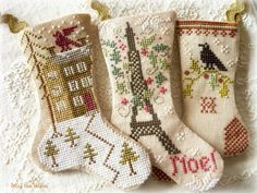 Blackbird Designs stockings stitched by Siobhan - (R to L) - 'Snowy Eve'/'Souvenir of Paris'/'WinterSong'