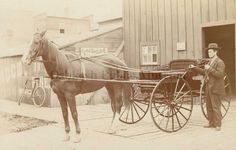 Photograph from the late 1890s of George Freeman and a horse drawn buggy.  (Oshkosh Public Museum)