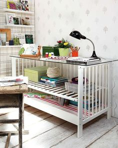 Grown-Up Desk: Add a glass top, turn one side rail into a shelf, and you're set. Wow, right?  Our crib is a dropside, which is recalled, so this is great way to reuse it.  Source: Achados Dedecoracao