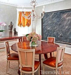 This dining room is wrapped in shimmering silver-leaf wallpaper for a stunning effect - Traditional Home® / Photo: Werner Straube / Design: Tom Stringer