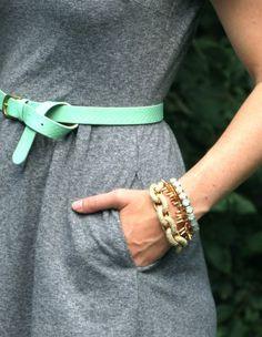 gray dress, mint belt, mixed bracelets