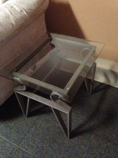 """SOLD - Glass Coffee Table w/ Matching Side Table  This beautiful metallic brown wrought iron coffee & side table with beveled glass is in great condition. Dimensions: Coffee Table - 48"""" W x 24"""" D x 18 1/2"""" H Side Table - 20"""" W x 24"""" D x 21 1/4"""" H www.relovedinteriors.com"""