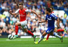 Calum Chambers of Arsenal is closed down by Cesc Fabregas of Chelsea during the Barclays Premier League match between Chelsea and Arsenal at Stamford Bridge on October 4, 2014 in London, England.