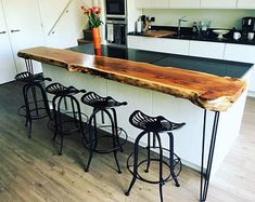 Live Edge Wood Breakfast Bar Providing live edge breakfast bars in all common and exotic woods, Woodland Interiors found this rare thick yew slab. Originally purposed for a table top, we transformed it into a breakfast bar. Live Edge Bar, Live Edge Wood, Banquette Seating, Home Remodeling, Home Furnishings, Kitchen Remodel, Interior Design, Breakfast Bars, Nice Breakfast