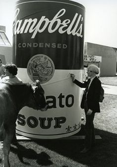 Andy Warhol signing the Campbell's Tomato Soup Can at Colorado State University.