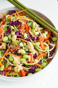 This recipe for raw rainbow pad thai leaves out traditional noodles and uses Summer zucchini noodles instead for extra flavor and crunch.
