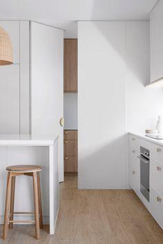 Coastal Kitchen Design, Classic White Kitchen, Kitchen Cabinetry, Hidden Door Bookcase, Clutter Free Kitchen, White Coastal Kitchen, Laminate Doors, White Cabinetry, Kitchen Design
