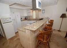 Nice ocean-view open kichen with granite counters and new appliances