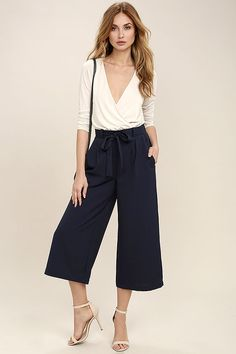The Sunny Stroll Navy Blue Culottes are sure to brighten up your day! A tying waist (with elastic at back) tops these chic woven culottes in classic navy blue. Front diagonal pockets.