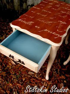 WOW! End table with French script. LOVE that they painted the inside of the drawer blue! Stiltskin Studios: Worth the Effort...