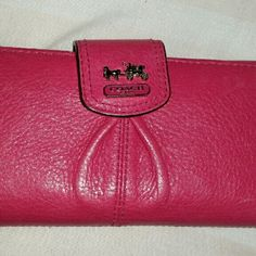 AUTHENTIC BRAND NEW REAL LEATHER COACH WALLET AUTHENTIC Brand new,never been used,amazing condition. Hot pink real leather with flap close and zipper back. Coach Bags Wallets